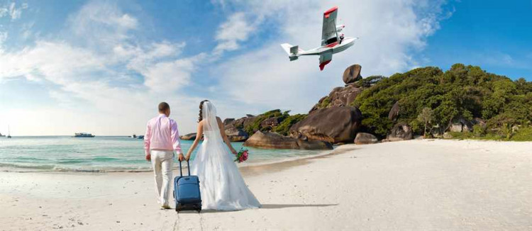 happy newly married couple  in honeymoon, on sun sandy beach in Thailand